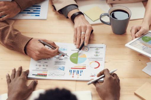 Risk Communicators strategize in a workspace.